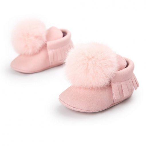 Roze babyschoenen met pompons